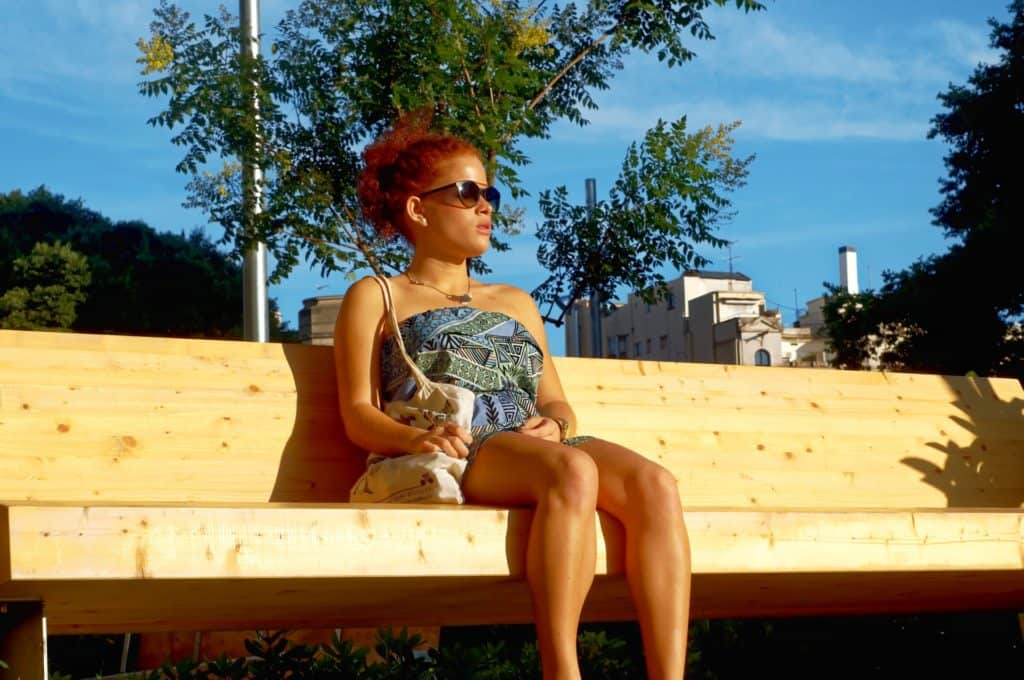 girl sitting on bench barcelona