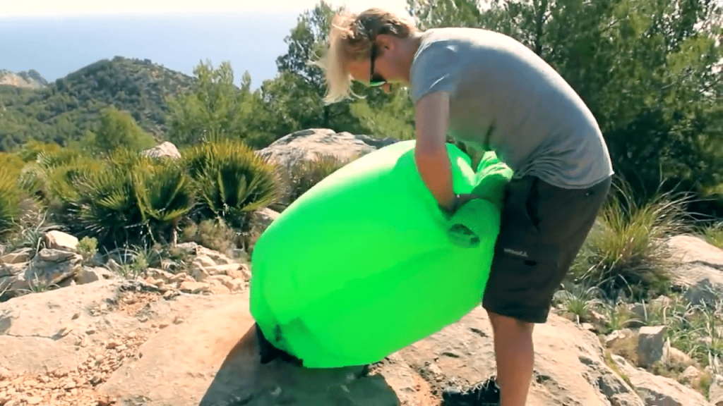 rolling and deflating inflatable lounger